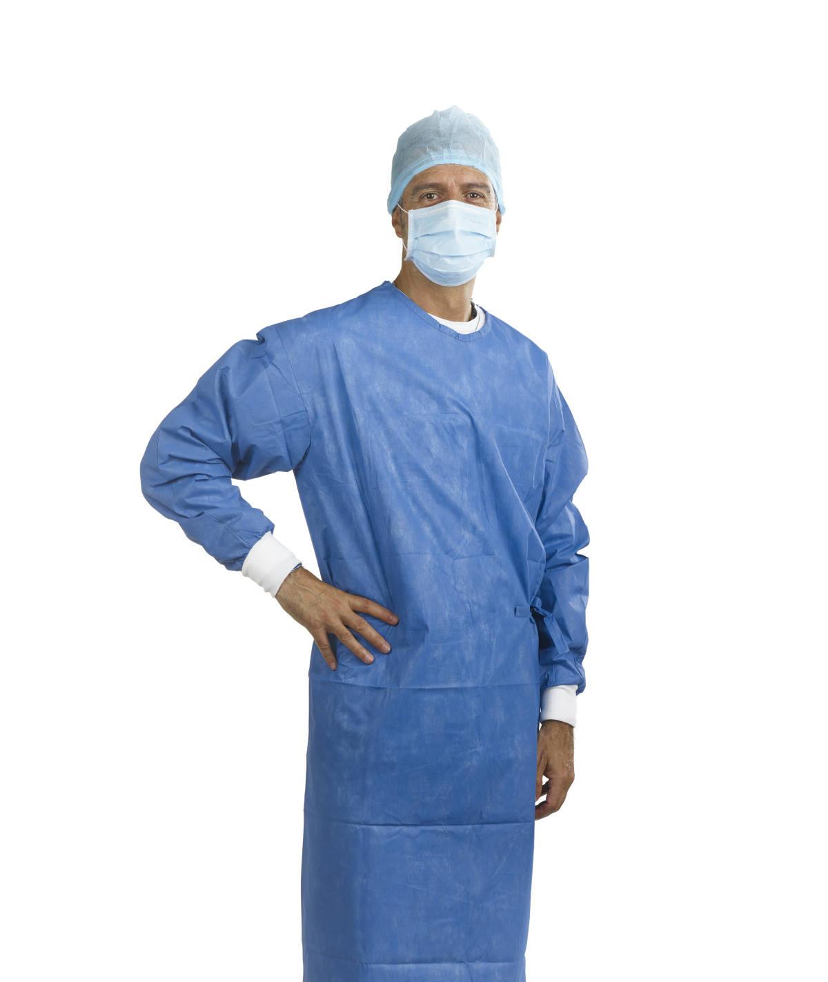 Behandler mit OP-Haube, Mundschutz & Kittel steril